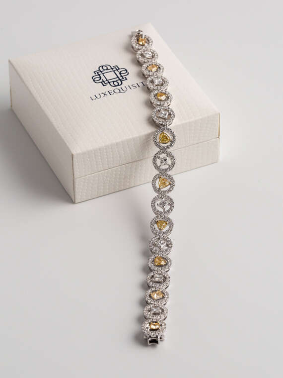 Fancy Coloured Diamond Bracelet in Pave Halo Setting